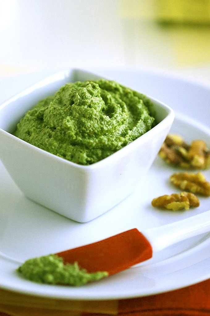 A bowl of pesto sauce on a plate
