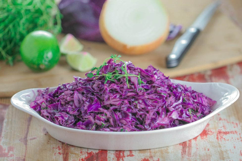 A bowl filled with purple cabbage slaw