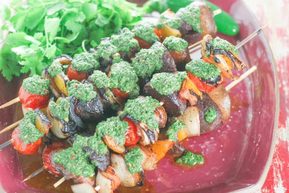 A platter of vegetable skewers cooked on the barbecue with sauce