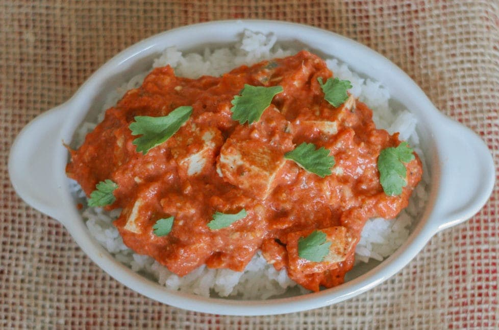 An overhead shot of vegan Indian dish topped with basil