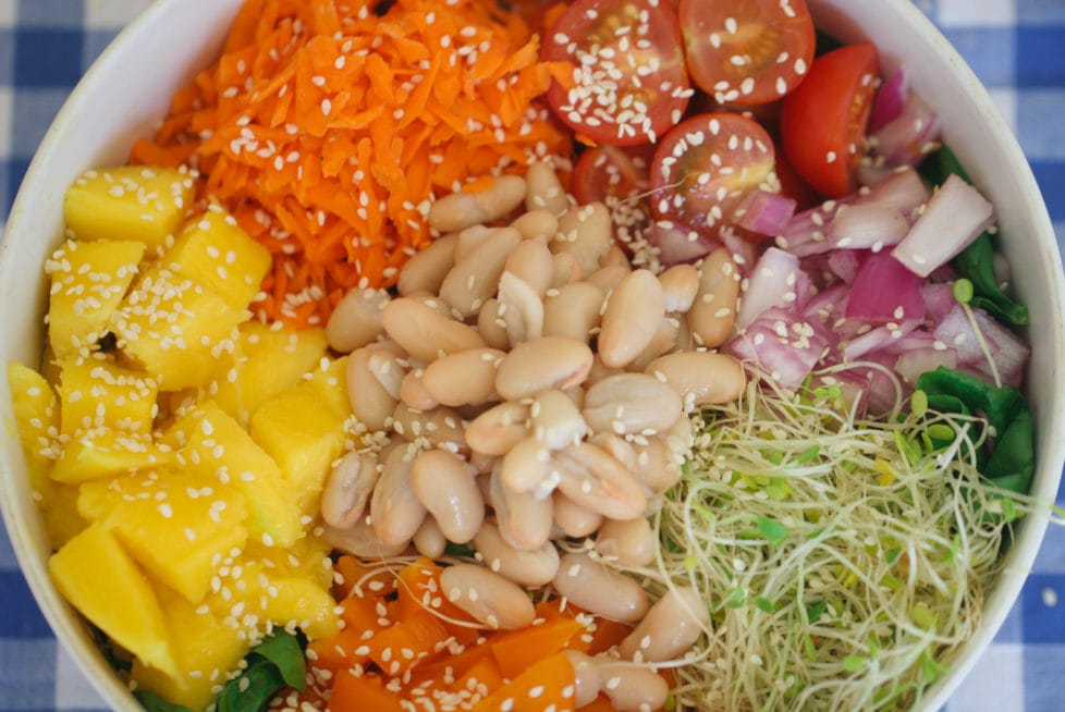 A close up of ingredients in bowl of salad