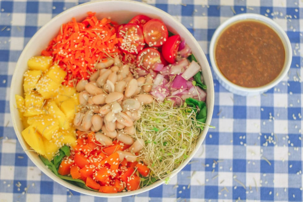 An overhead shot of salad in a white bowl