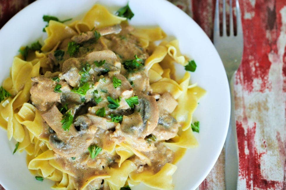 A close up of a plate of mushroom stroganoff