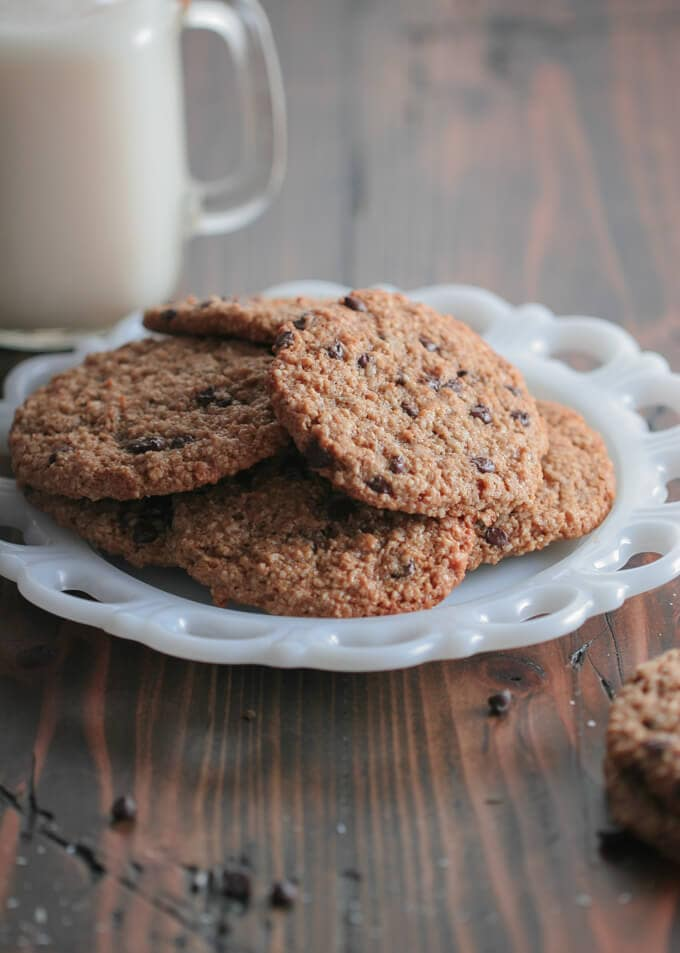 cookies on a white plate sitting on a wooden table