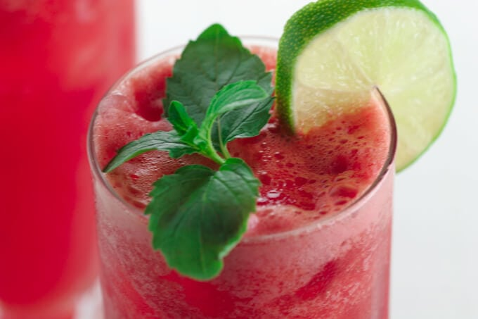 A close up of a glass of Watermelon fresca and Mint
