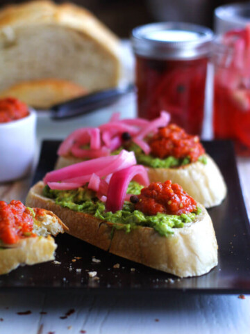 A close up of a avocado tartines on a platter