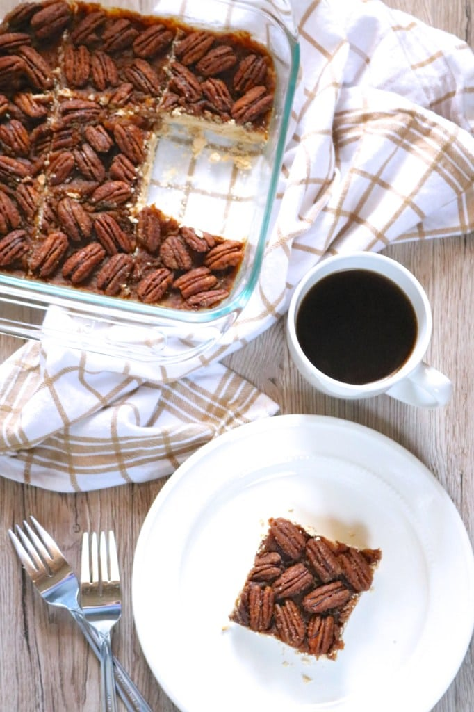 A plate of pecan pie bars on a table