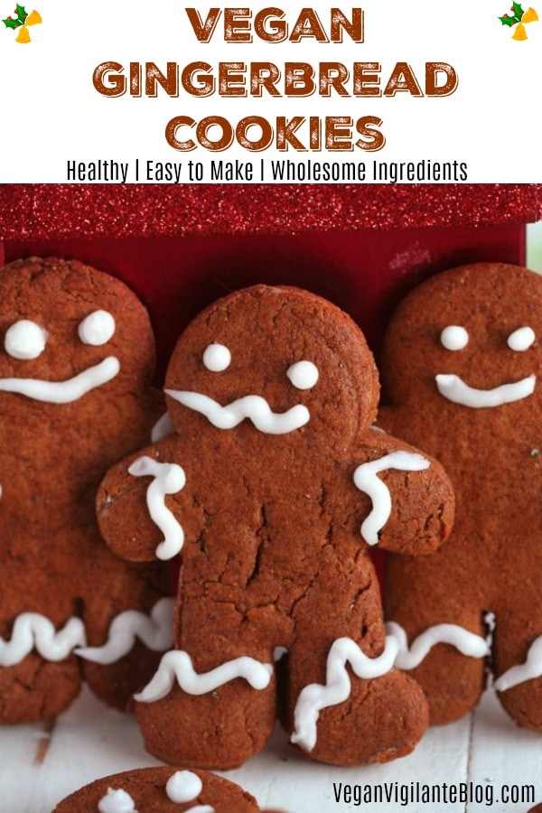A closeup of 3 gingerbread men with smiles on their faces