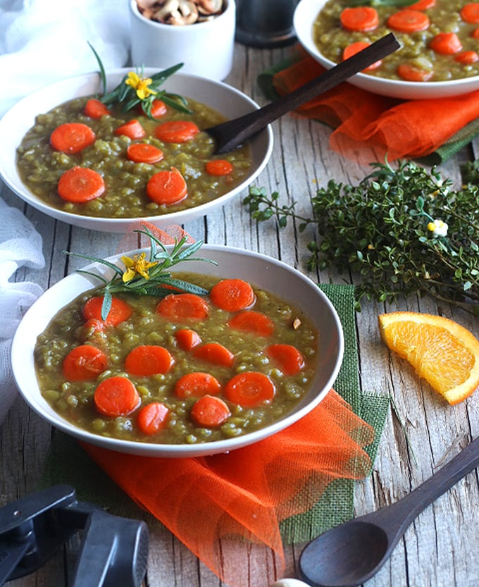 two bowls of soup with carrots and split peas