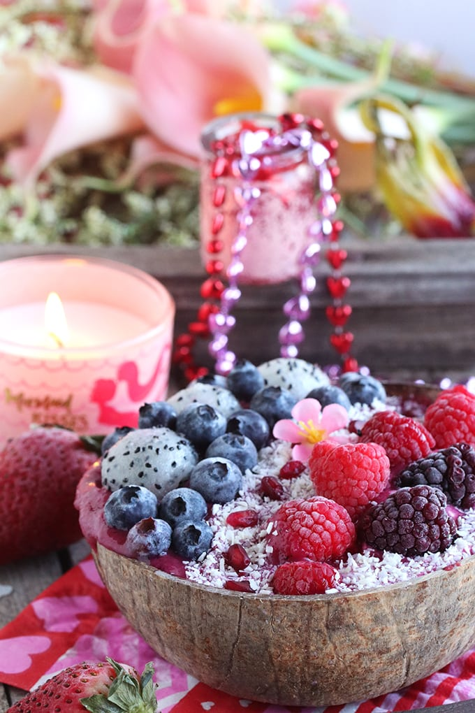 A close up of smoothie bowl topped with berries