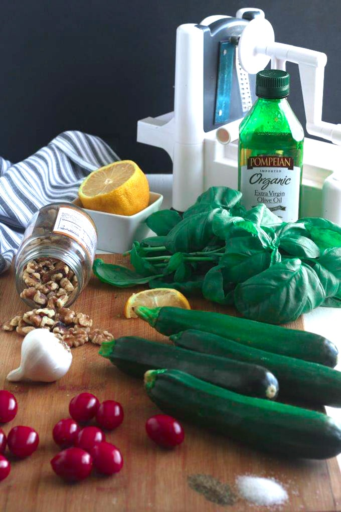 ingredients for Walnut Pesto Zoodles on a cutting board