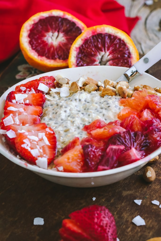 Closer front view of Blood Orange Overnight Oats in white bowl