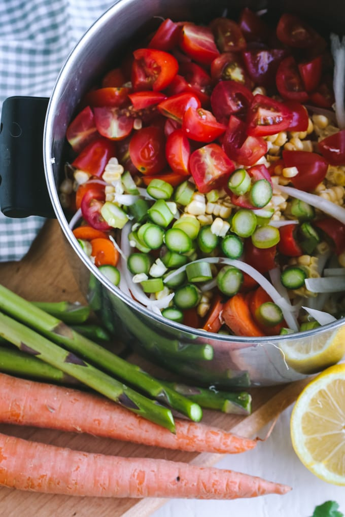PIcture of vegetables added to a metal pot for asparagus salad