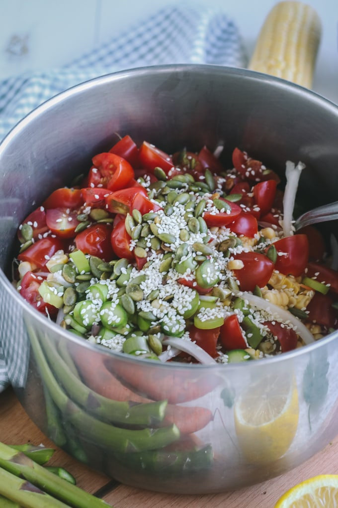 Picture of Seeds Added to Vegetables in Metal Pot for Chilled Asparagus Salad