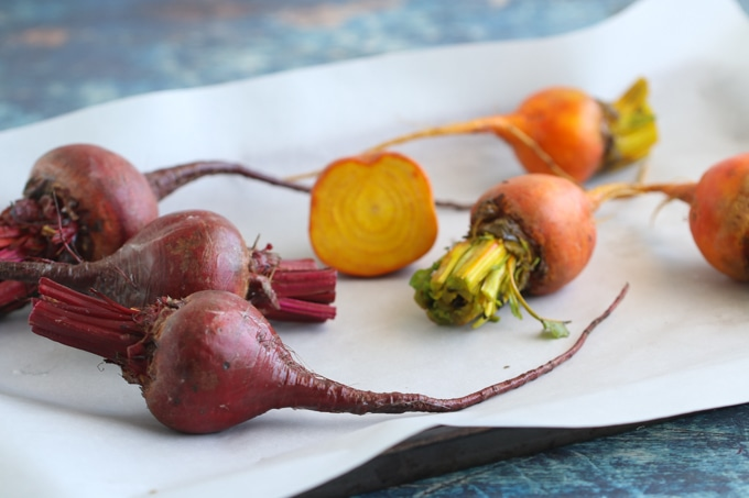 Red and Yellow Beetroot on a Parchment-Lined Baking Sheet