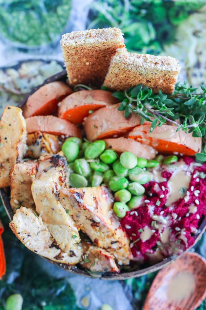 Overhead Picture of Roasted Beet Hummus with Tofu and Sweet Potatoes in Coconut Bowl