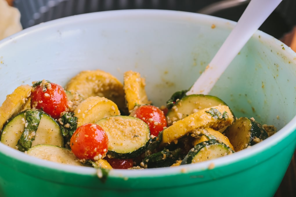 A bowl of ingredients to make tart with tomato and zucchini