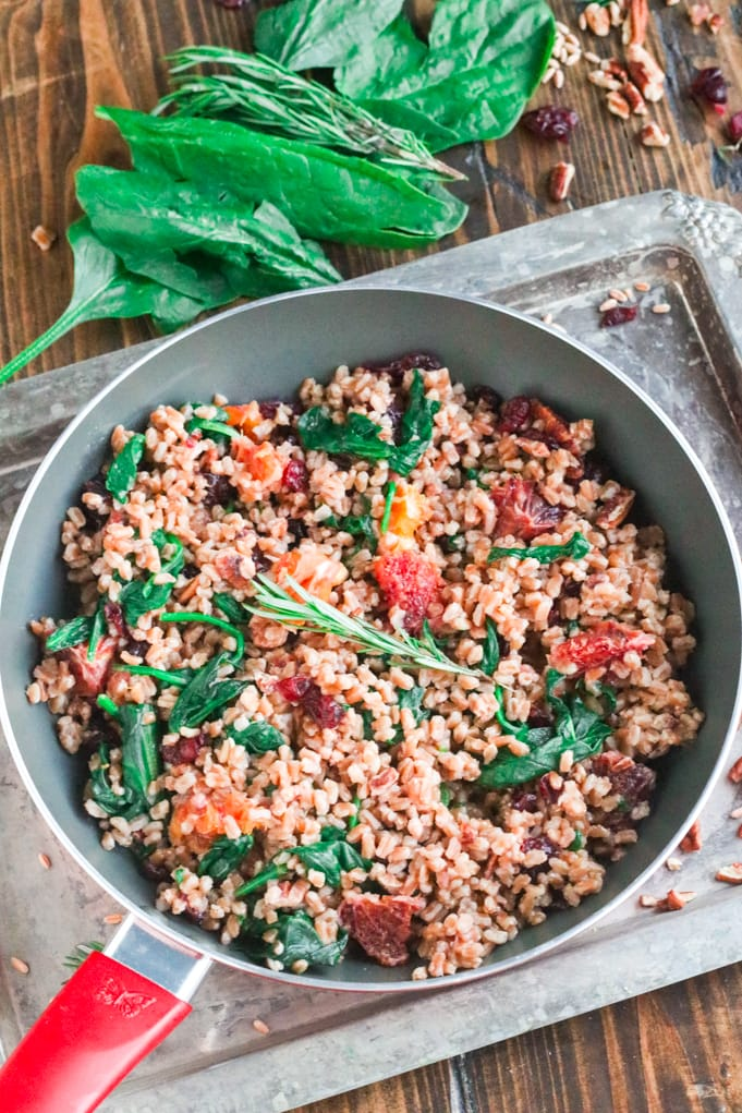 A skillet of food, with Farro and Spinach