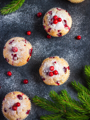 overhead shot of vegan muffins with cranberry on a gray table