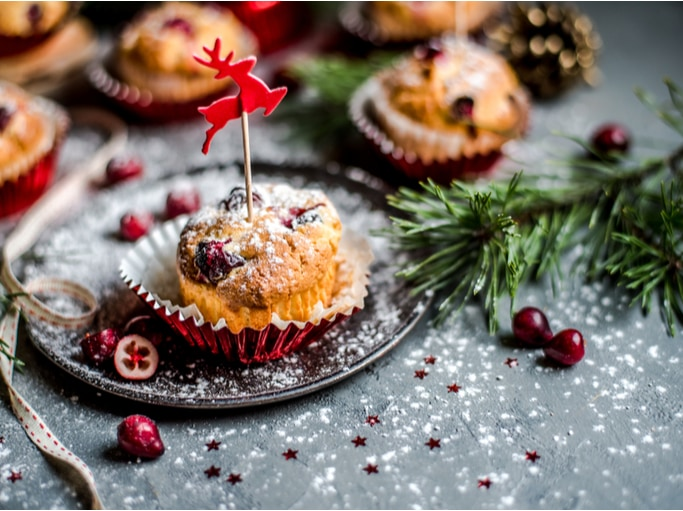 A gray table with cranberry muffins on top