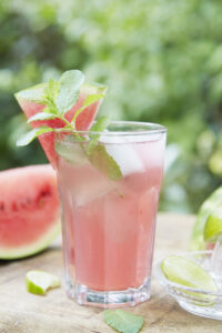 glass of watermelon drink on an outdoor table