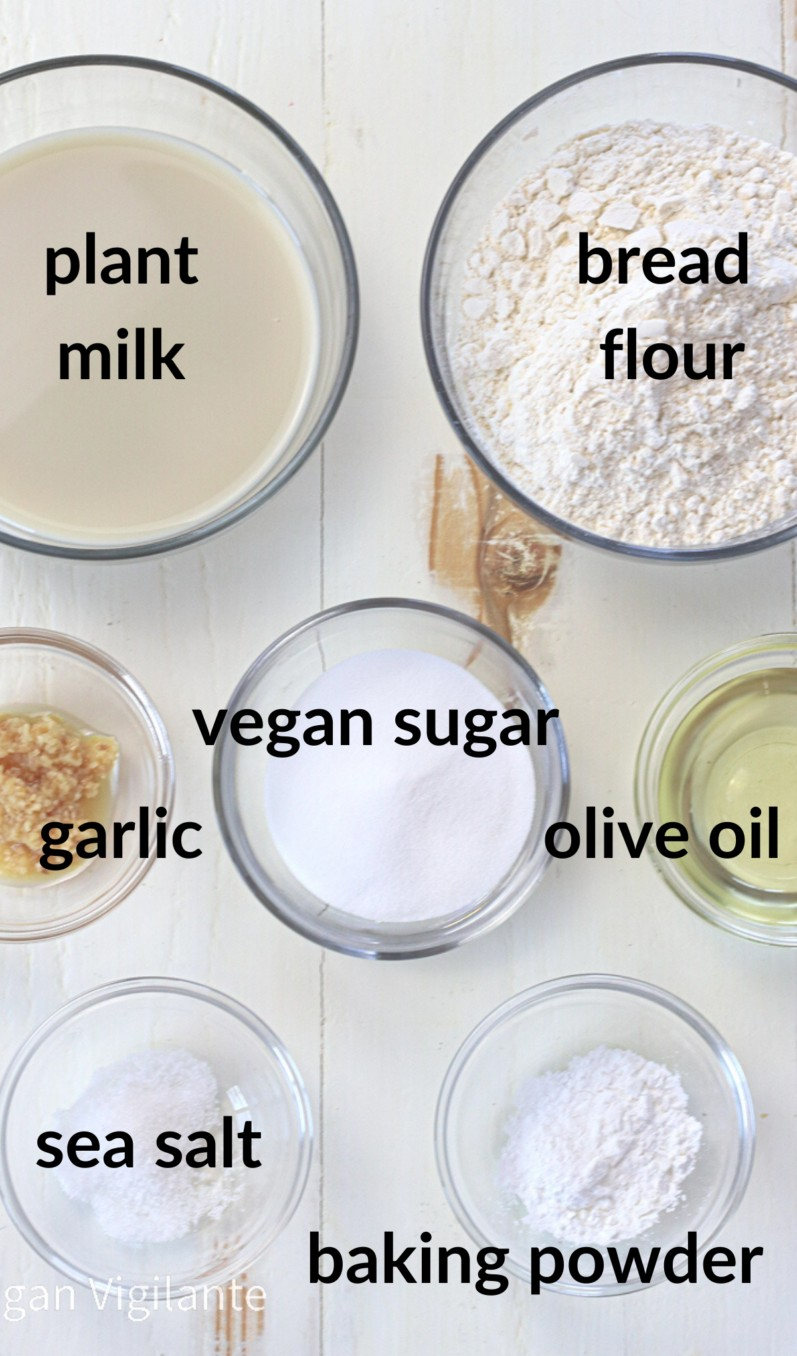 ingredients for vegan naan bread sitting on a white table in bowls