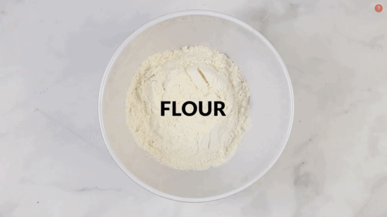 bowl of flour on a white table