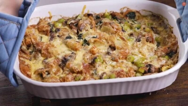 stuffing just out of the oven in a white casserole dish