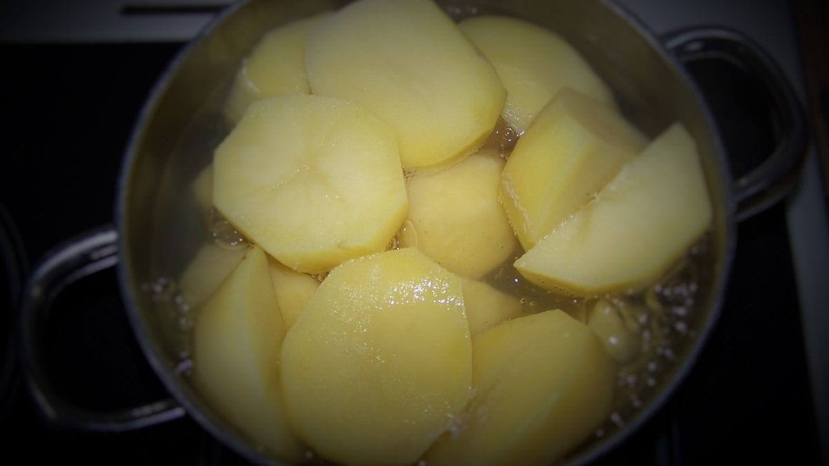potatoes in a pot covered with water waiting to boil