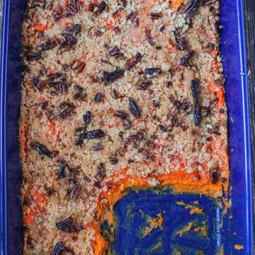 vegan sweet potato casserole in blue dish with serving removed