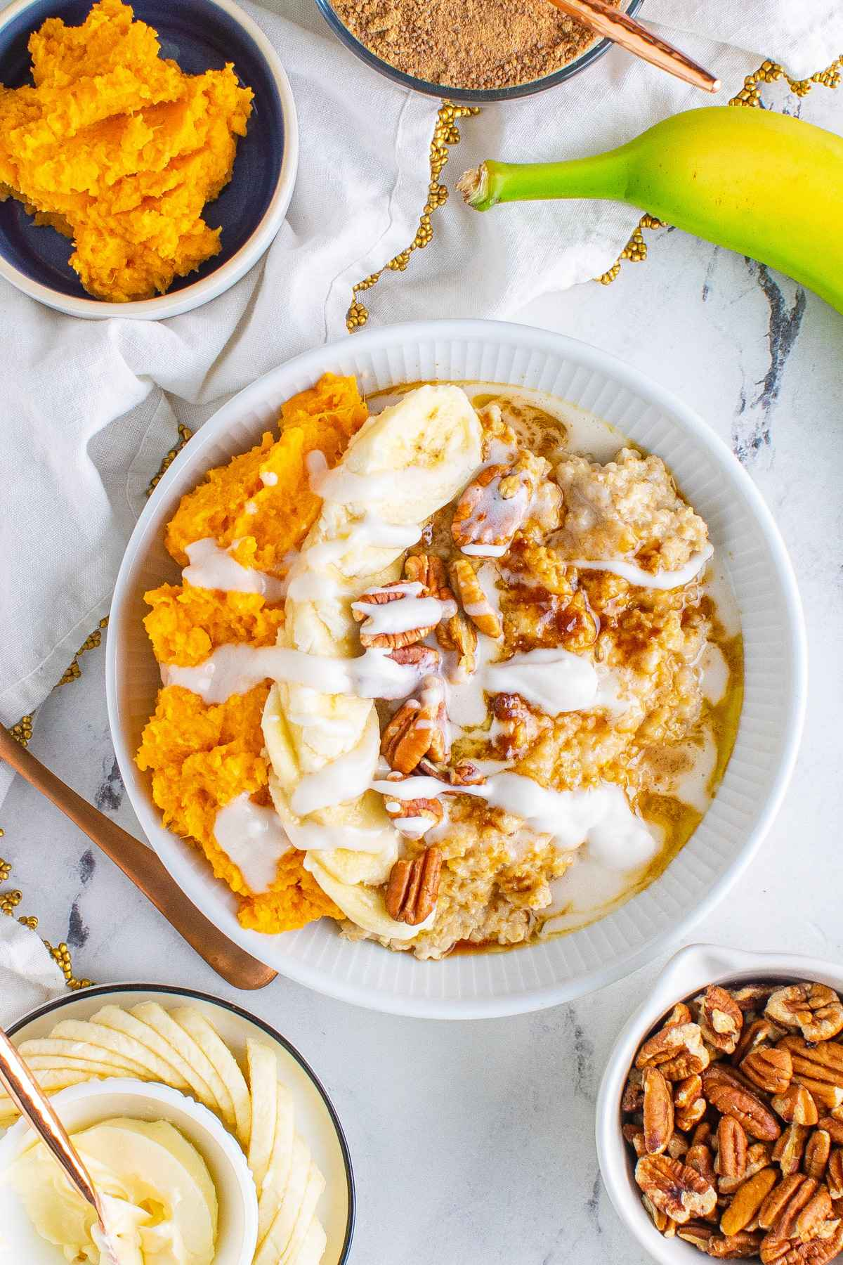 sweet potato oatmeal in white bowl on marble table